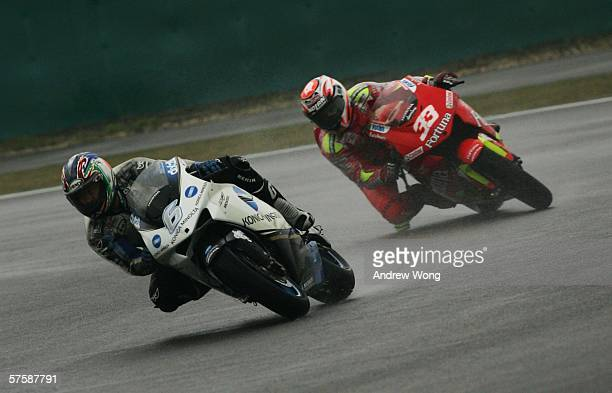 Japanese Makoto Tamada of Konica Minolta Honda and Italian Marco Melandri of Fortuna Honda turn a corner during the practice session at the China...