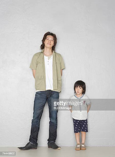 Japanese man and boy standing with smiling