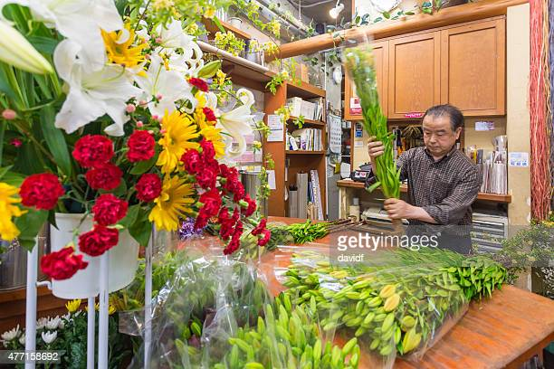 Japanese Man Arranging Flowers in a Florist Shop in Tokyo