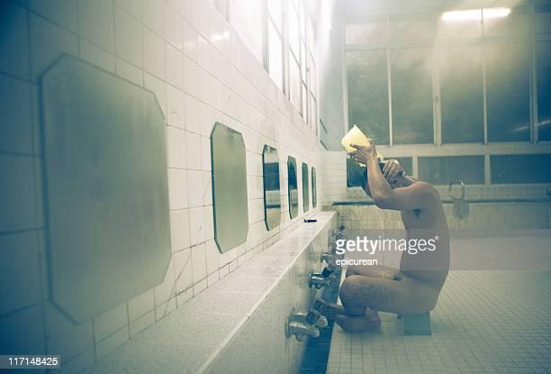 Japanese man bathing at traditional Onsen