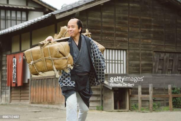 Japanese man carrying his trade goods, Edo period village