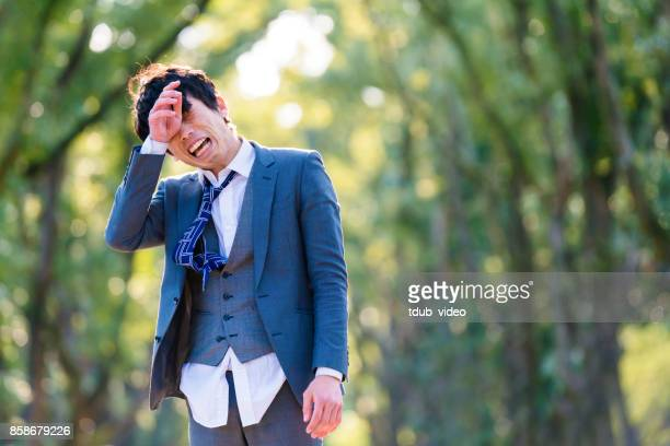 japanese man crying outside - tdub_video stock pictures, royalty-free photos & images