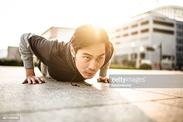 Japanese man doing push-ups