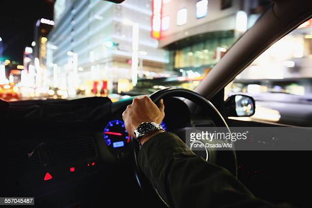 Japanese man driving his car in the Tokyo streets