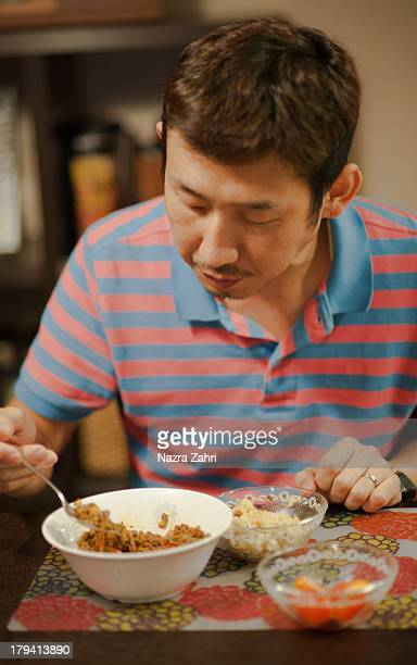 Japanese man eating dinner at home