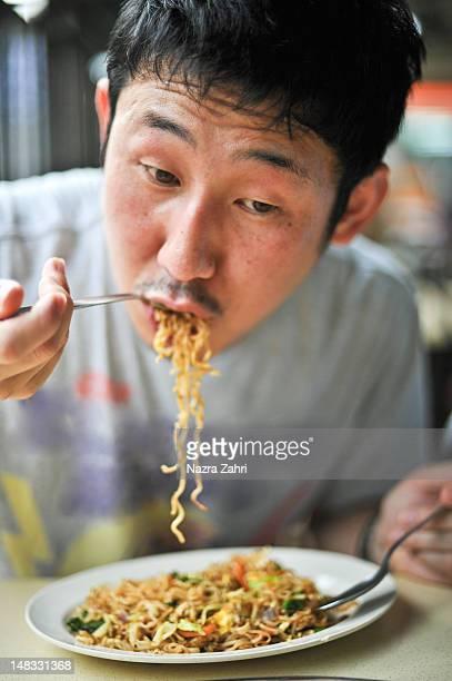 Japanese man eating fried noodles