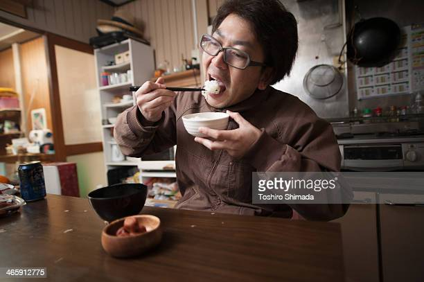 Japanese man eating rice