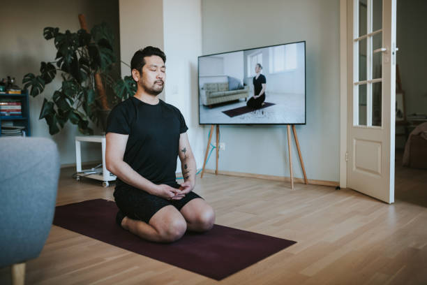 japanese man exercising at home - meditate stock pictures, royalty-free photos & images