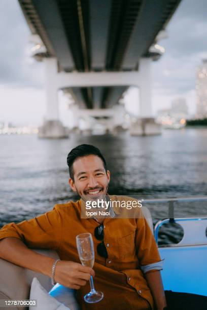 japanese man having a good time on boat, tokyo bay - tokyo japan stock pictures, royalty-free photos & images