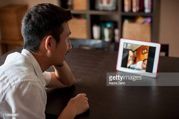 Japanese man having a video call