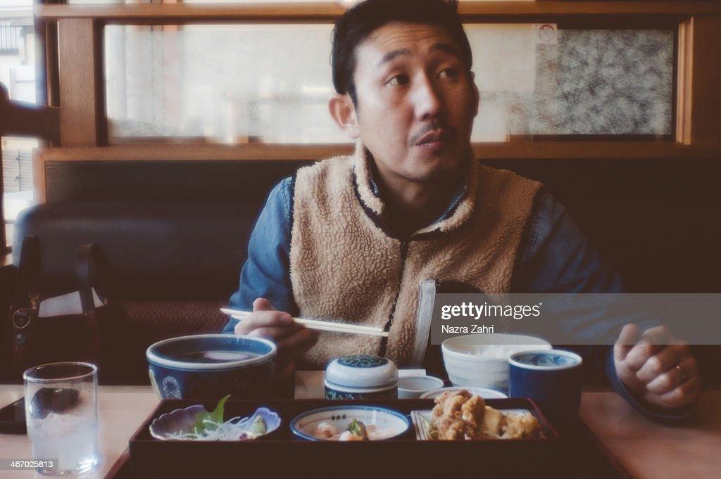 Japanese man having Japanese lunch at a restaurant : Stock Photo