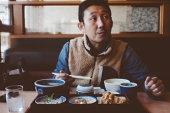 Japanese man having Japanese lunch at a restaurant