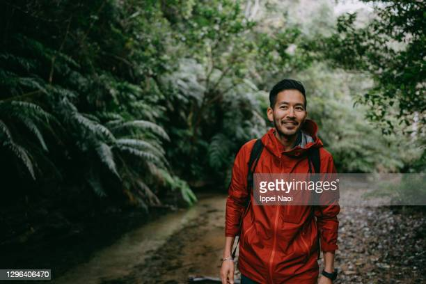 japanese man hiking in rainforest, okinawa, japan - leisure activity stock pictures, royalty-free photos & images