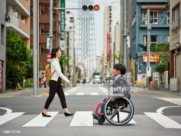 Japanese Man in a Wheelchair with Young Woman