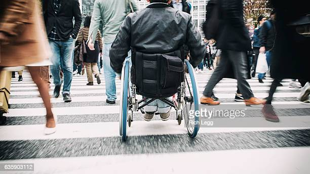 japanese man in wheelchair - pedestrian crossing stock photos and pictures