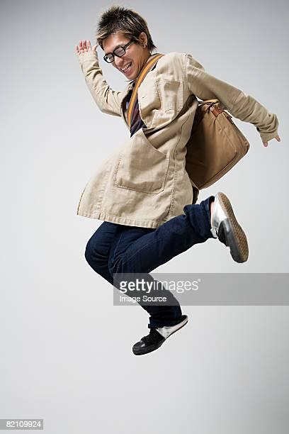 Japanese man jumping for joy