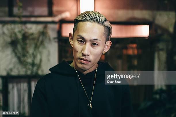 japanese man looking at camera - 金髪 ストックフォトと画像
