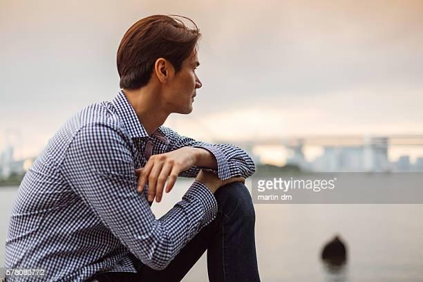 Japanese man looking at view