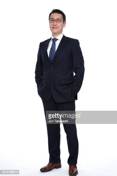 japanese man on white back ground - hands in pockets stock photos and pictures