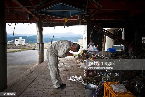 Japanese man pays his respect prior to the sixth month anniversary of the March 11 earthquake and massive tsunami on September 10 2011 in...