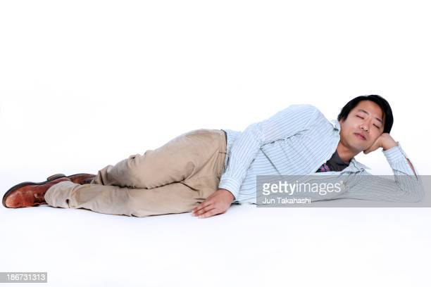 japanese man - lying on side stock pictures, royalty-free photos & images