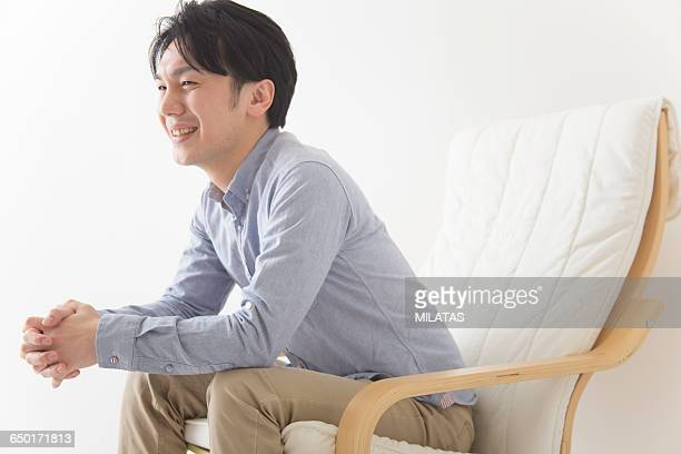 japanese man relax in the chair - long sleeved stock photos and pictures