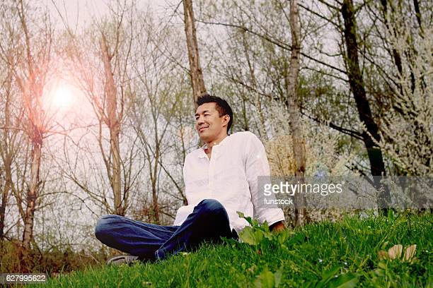 Japanese man relaxing in the park after work