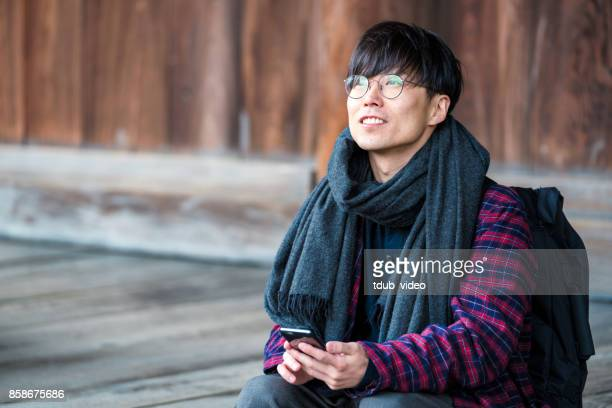 japanese man sitting at hyakumanben chionji temple - tdub_video stock pictures, royalty-free photos & images