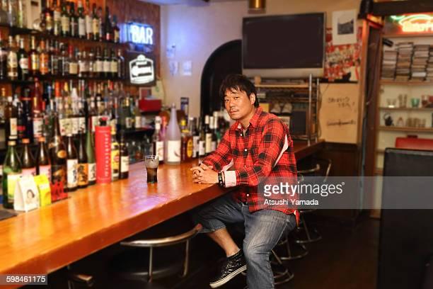 Japanese man sitting in bar