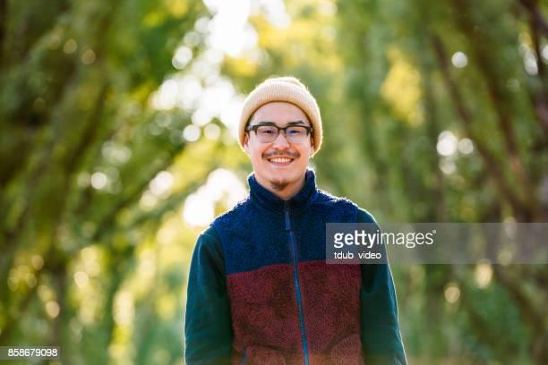 Japanese man smiling at camera