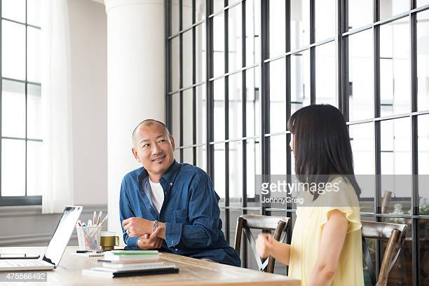 Japanese man smiling at desk