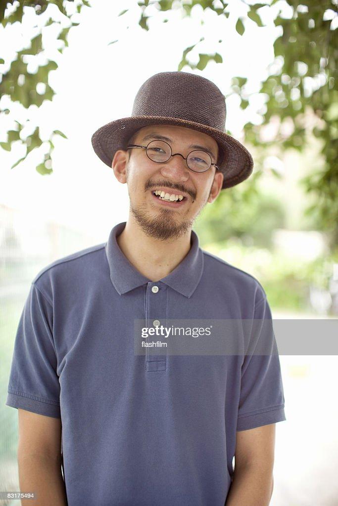 Japanese man, smiling : Stock-Foto