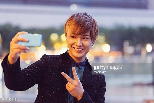 Japanese man taking selfie