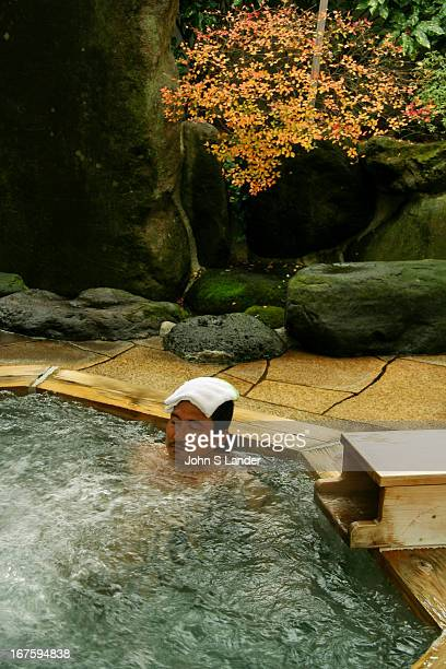 Japanese Man Taking the waters at Yajikitanoyu Hot Springs in Hakone Japan Japanese onsen or hot springs are a popular leisure activity among the...