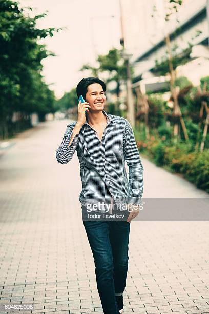 japanese man talking on the phone - lypsekyo16 stock pictures, royalty-free photos & images
