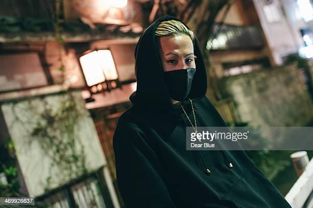 Japanese man under street light