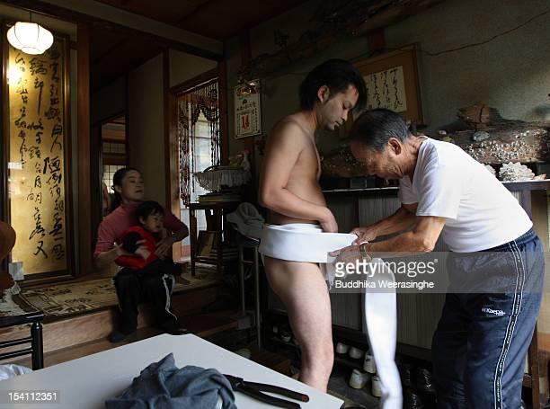 Japanese man wears Fundoshi or loincloth as he prepares for Nada Kenka Matsuri or Nada Fight Festival on October 14 2012 in Himeji Japan The festival...