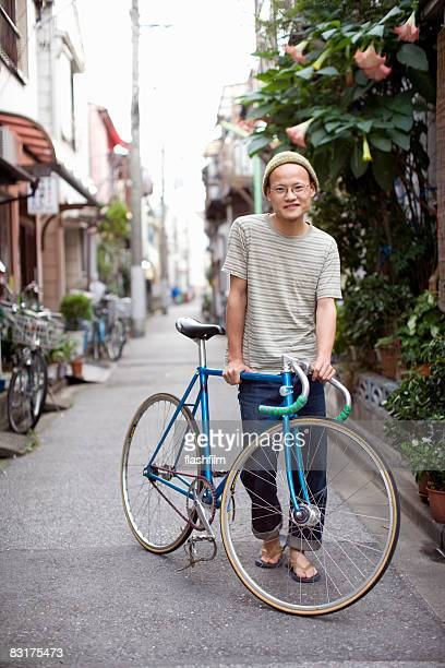 Japanese man with bike on the street