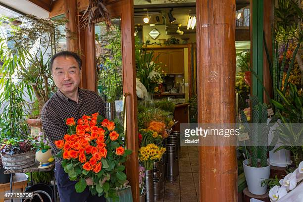 Japanese Man With Flowers Outside His Florist Shop in Tokyo