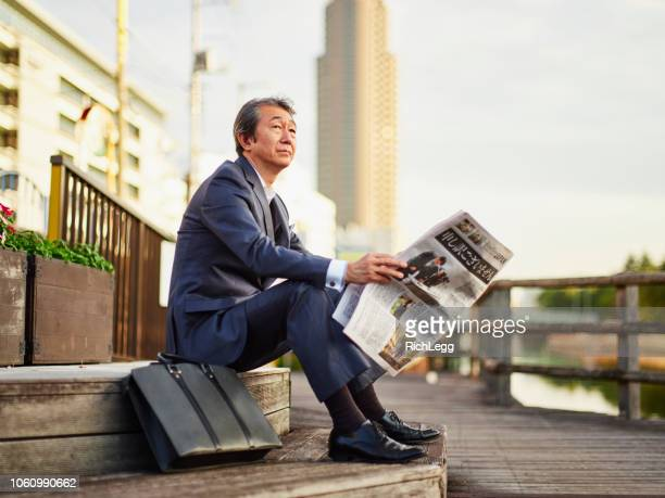 Japanese Man with Newspaper