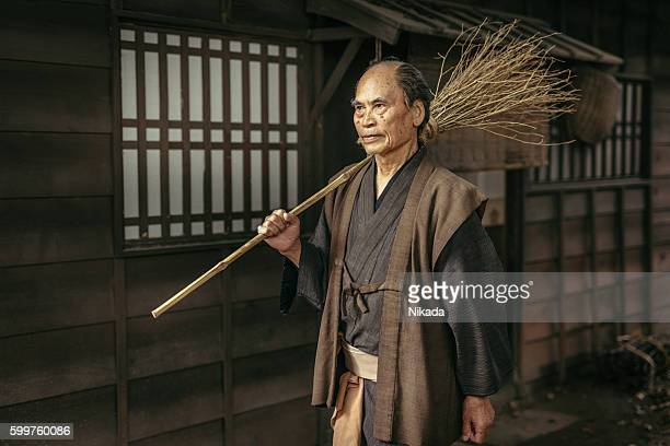 Japanese Man with straw broom