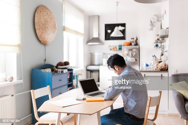Japanese man works with laptop
