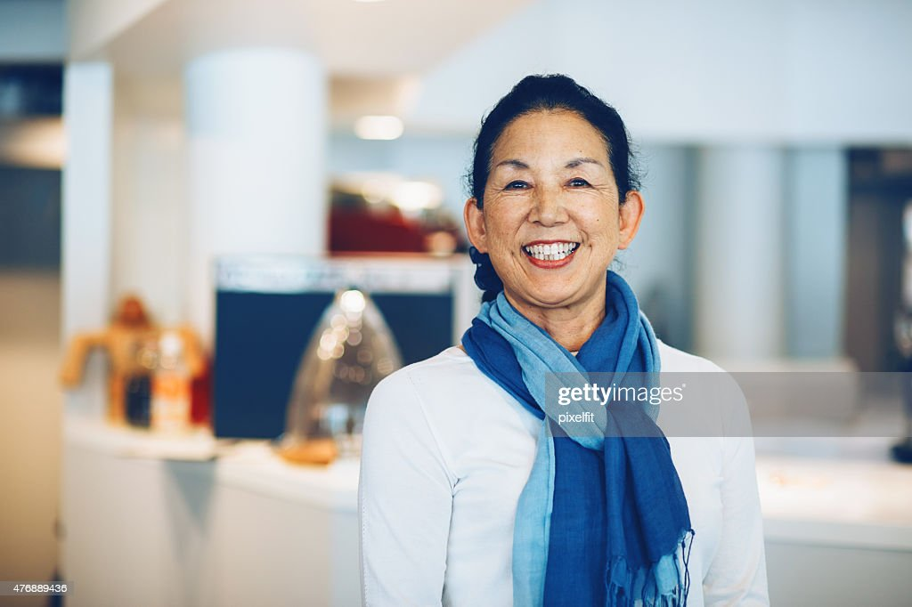 Japanese manager in coffee shop : Stock Photo