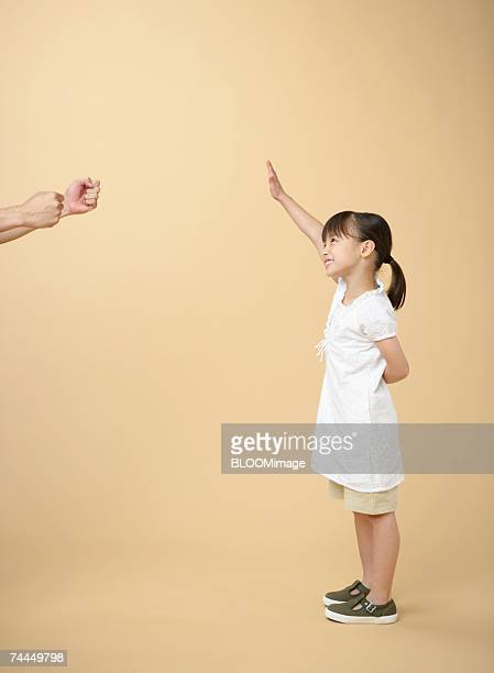 Japanese man's hands and Japanese girl reaching hand with smiling