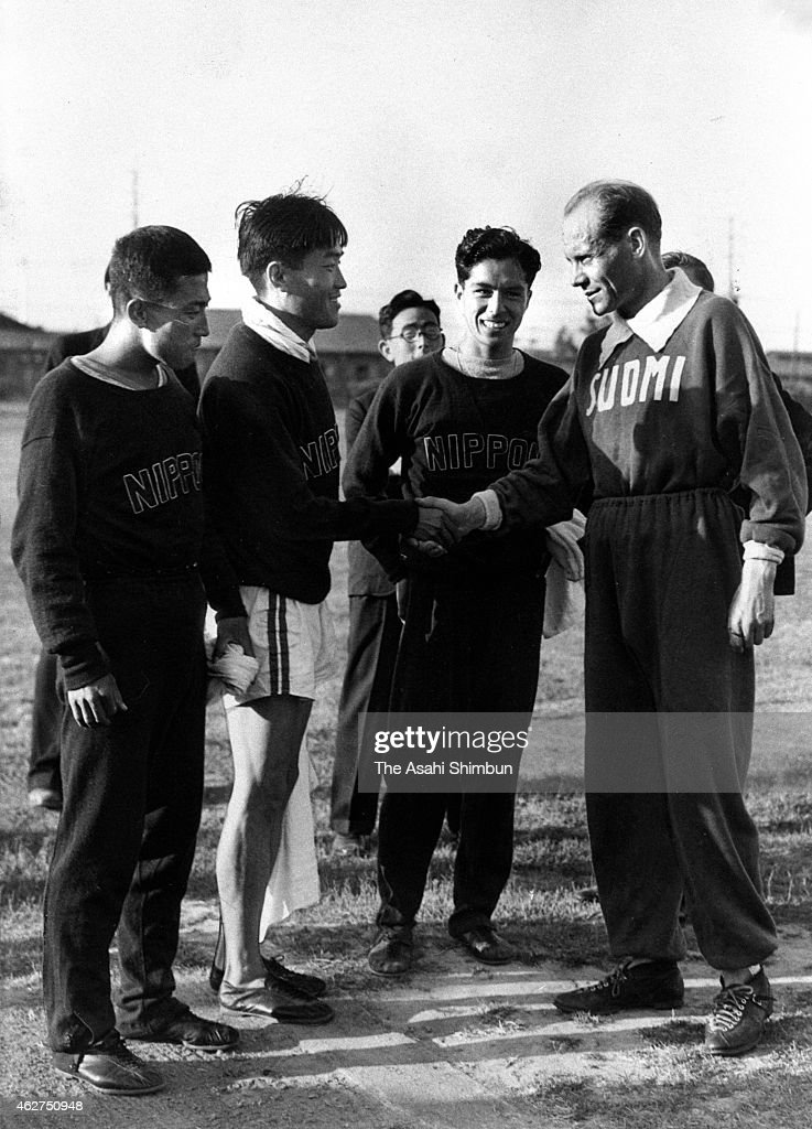 Japanese Marathon team members Onbai Kin or Kim Un-Bae (1st L), Taika Gon or Kwon Tae-Ha (2nd L) and Seiichiro Tsuda (2nd R) shake hands with 9-time olympic gold medalist Paavo Nurmi of Finland at a training session ahead of the 1932 Los Angeles Olympic on July 13, 1932 in Los Angeles, California.