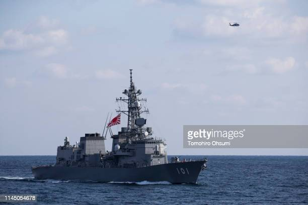Japanese Maritime SelfDefense Force's Murasame destroyer sails near British Royal Navy's HMS Montrose frigate during a joint exercise with US Navy on...