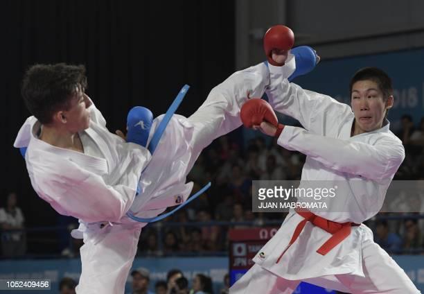 Japanese Masaki Yamaoka and Iranian Alireza Farajikouhikheili compete in the Men's Kumite 61 kg qualifying bout during the Youth Olympic Games in...