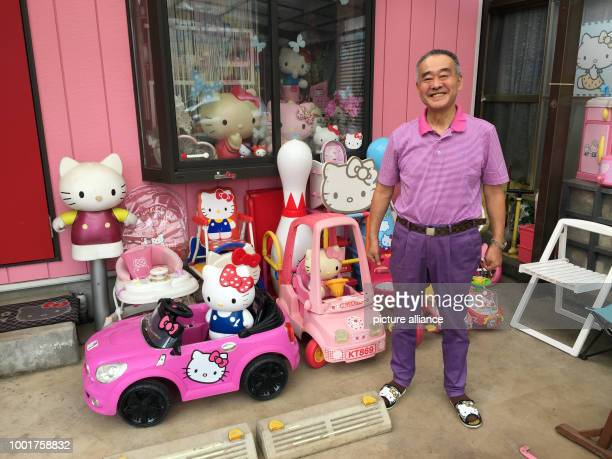 Japanese Masao Gunji who owns the world's greatest Hello Kitty collection is pictured in front of a Kitty House built next to his residential house...