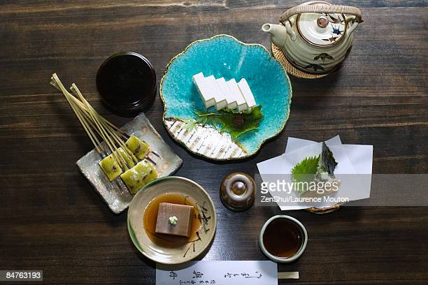 japanese meal with various tofu dishes and tempura vegetables, overhead view - washoku fotografías e imágenes de stock