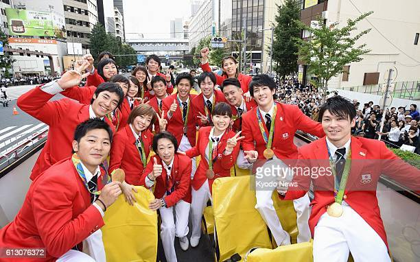 Japanese medalists from the Rio Olympics and Paralympics pose for photos during a parade in central Tokyo on Oct 7 2016 It was the second such event...